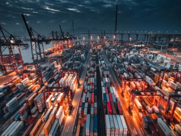 Shipping containers in port at night